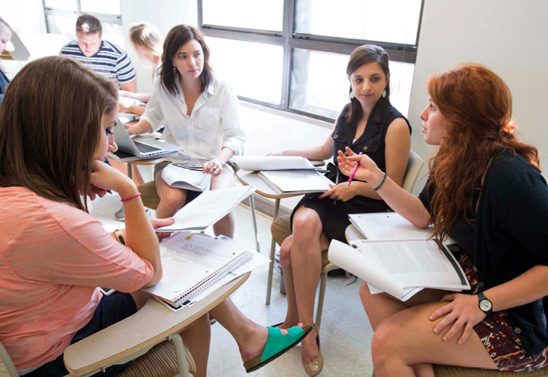 Female students talking in a circle